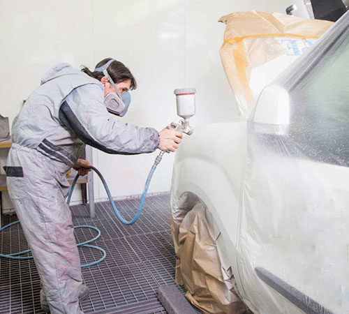 person painting a car